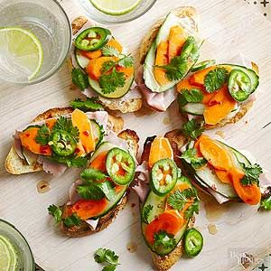 Banh Mi Bruschetta - A favorite Vietnamese sandwich gets reinvented as one of our best healthy snacks ever. This bruschetta tops toasted French bread with jalapenos, carrots, cilantro, and ham, plus a slather of soy sauce mayo. It's an irresistible riot of color, crunch, and fascinating flavors.