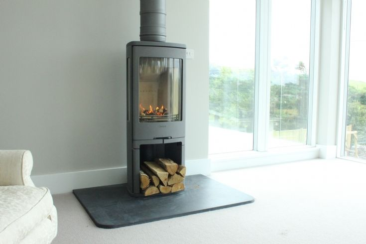 The Contura 750 installed into a new build in Rock by Kernow Fires in Cornwall. #contura #fire #stove #wood #burner #modern #contemporary #log #store #windows #new #build #hearth #kernowfires #wadebridge #redruth #cornwall