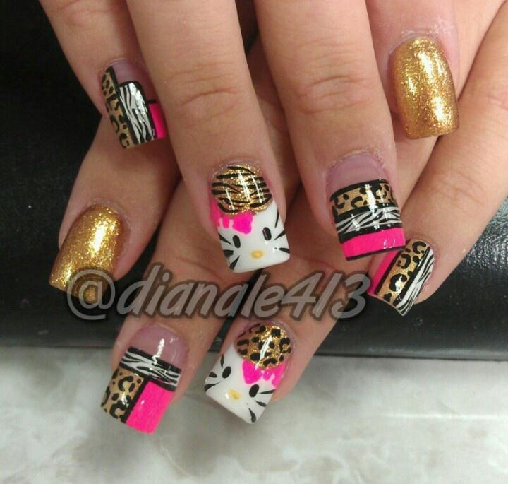 Cute hello kitty nail design with cheetah & zebra print.