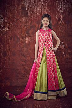 Brocade jacket embellished pearl, sequins and zardosi work paired with raw silk lehenga and net dupatta