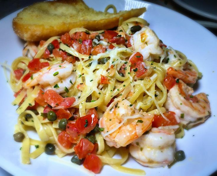 My new favorite dish at Bubba Gump is this light and lemony Shrimp Scampi with a lemon garlic butter capers & topped with Parmesan #AGWDineAround