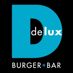 Delux... There is one in the West Edmonton Mall.  Very reasonably priced, super yummy burgers, fresh cut fries, and the bacon is battered and deep fried!!!