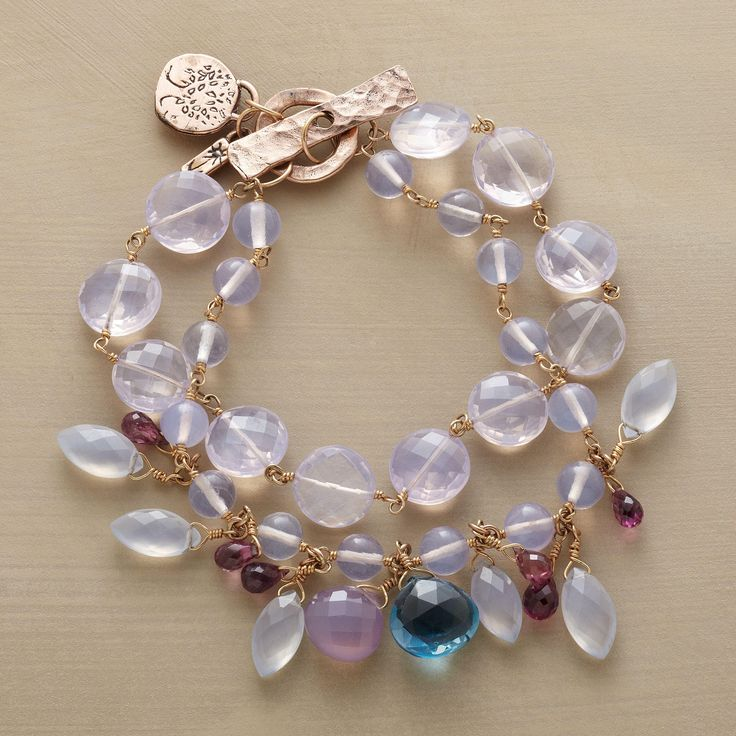 LAVENDER QUARTZ GARDEN BRACELET--Jes MaHarry offers a glimpse of her garden, sprinkling two strands of lilac quartz with amethyst briolettes, chalcedony and a showstopper London blue topaz. Exclusive. Handmade in USA with14kt rose gold toggle