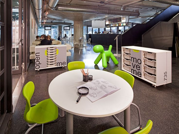 NATIONAL TECHNICAL LIBRARY, PRAGUE. Fantasy furniture series situated in the Czech National Technical Library demonstrates use of the special foil-stickers. Individually designed graphics is inspired by the navigation system in library and colours used in the interior. This graphics emphasizes characteristic features of the building. Coloured Fantasy handles contrast with the simple black and white graphics and match the colours of flooring.
