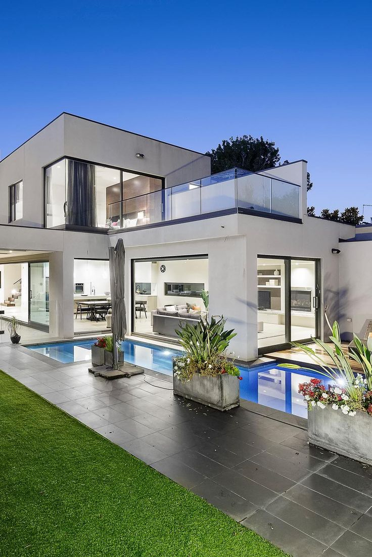 Contemporary House Architecture with a cool pool. Big windows and ...