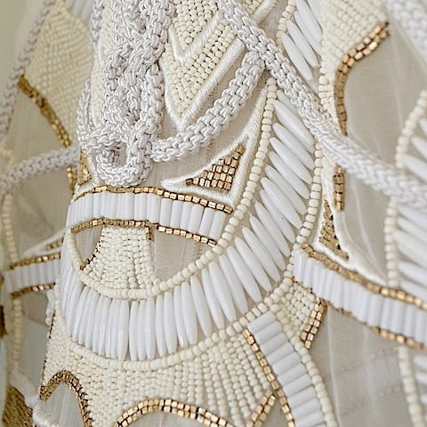 Sass  Bide, I love the use of diffrent shapes of white beads as they make the design