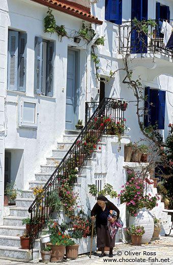 Yiayia walking in a Greek Island