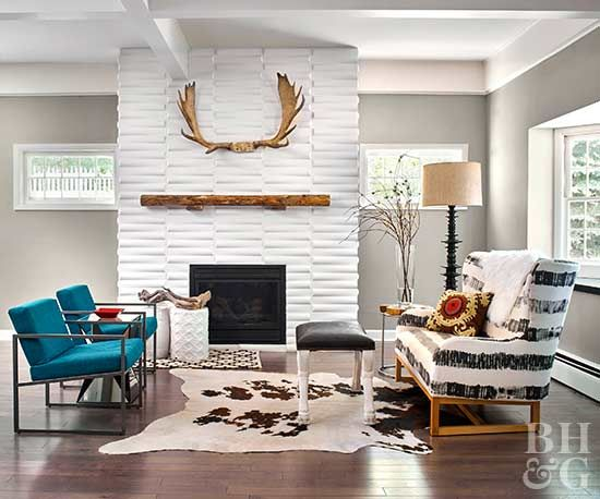 The homeowners said good-bye to dated wood paneling in favor of gray-painted drywall in their living room. For a contemporary twist, they amped up the character of the fireplace with a three-dimensional product made of recycled sugarcane waste. It installs like tile—but costs less—and it's paintable, so you can choose any color you want.