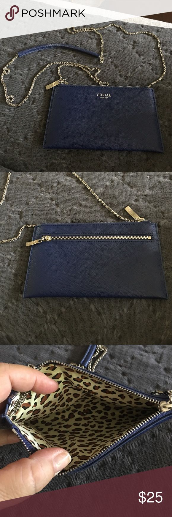 Sorial Navy Clutch with credit card holder Sorial Navy Blue Clutch that can be worn as a cross body with red Sorial credit card and license holder. Never used sorial Bags Clutches & Wristlets