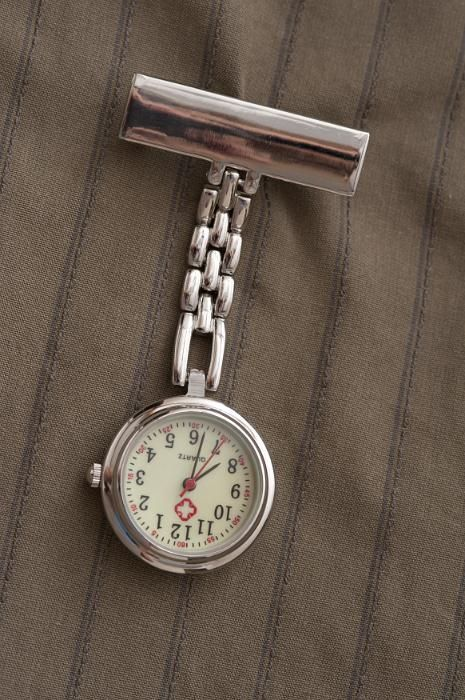 Nurses silver metal fob watch on a chain with a clip for fastening it to her…