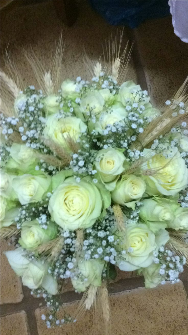 Bridal bouquet with roses, gyp and wheat