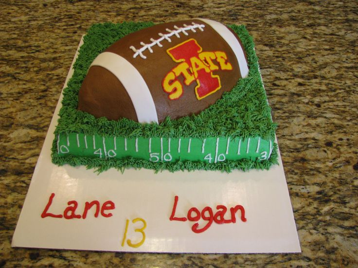 Iowa State football cake - We make this for my twin nephews for their birthday.  It was a little challenging, but it turned out good.  The football is a chocolate cake and the bottom is a almond white cake.  All buttercream except the side football white lines are fondant