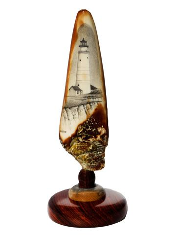 """""""Boston Light"""" Black and White Scrimshaw on Ancient Walrus Tusk Ivory Artifact by David Smith. Lighthouse lovers will know that is is the oldest lighthouse in America. The bottom bears scoring marks made by ancient Eskimos indicating that it was used as some type of tool or artifact hundreds and hundreds of years ago. The dark at the bottom of the tusk also gives the appearance of huge, jagged rocks on the cliffside. Size: 2"""" Diameter x 6""""H  Price: $600.00  -- on ScrimshawGallery.com…"""