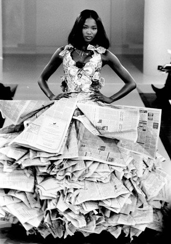 Naomi Campbell wearing a wedding dress made from newspapers and dollar bills as part of the New Renaissance collection at the Harvey Nichols and Perrier New Generation Designers Show, 1994