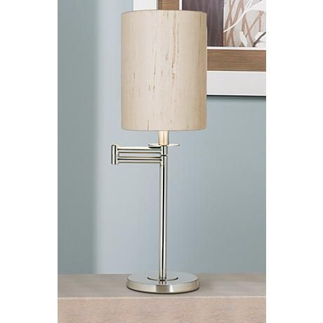 Blending simple style and user friendly design this contemporary brushed nickel swing arm desk lamp