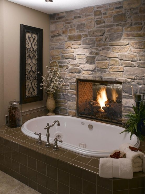Fireplace between the master bedroom and tub love