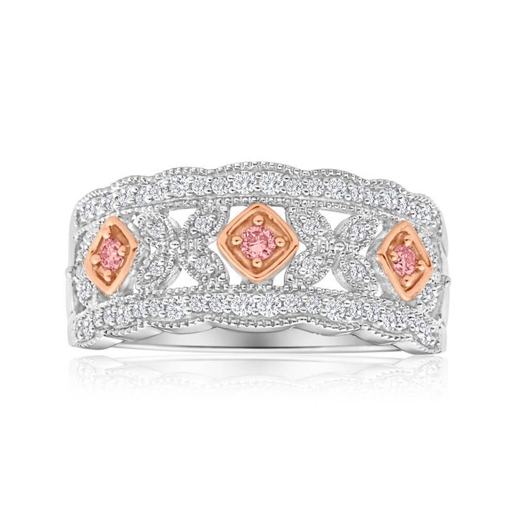 Unique wedding ring style. Pink argyle and White Diamond Ring in 18ct Gold. Stand out from the crowd with this stunner!