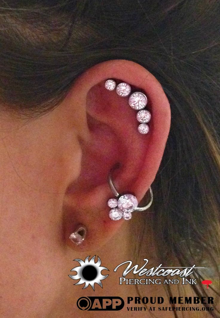 """Another elegant 5 cz cluster from Anatometal and her conch has a dimpled cluster """"caeli"""" by Industrial Strength in cz."""