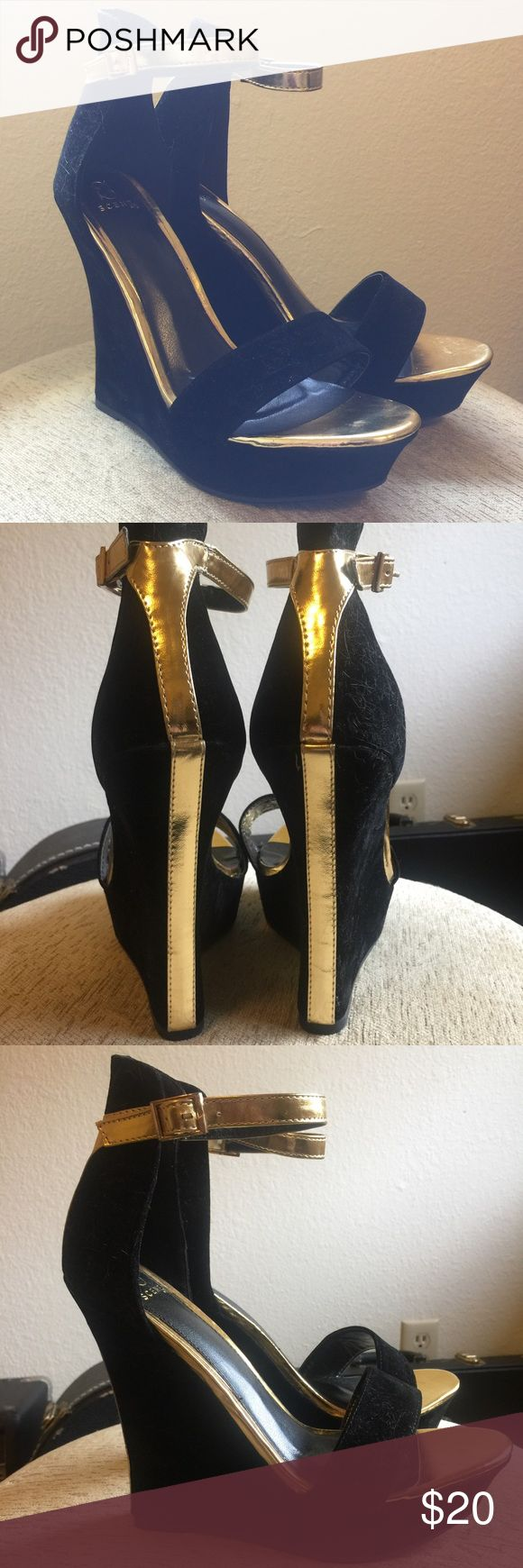 Black and Gold Wedge Heels Beautiful black and gold wedge heels! Super soft velvet material on the outside. These shoes make a perfect accent to an outfit. 👠  NWOT NEW WITHOUT TAGS!! These have never been worn.   Color: Black and Gold Size: 8.5  All items come from a clean, smoke free home.  ❌No Trades❌ Shoes Wedges