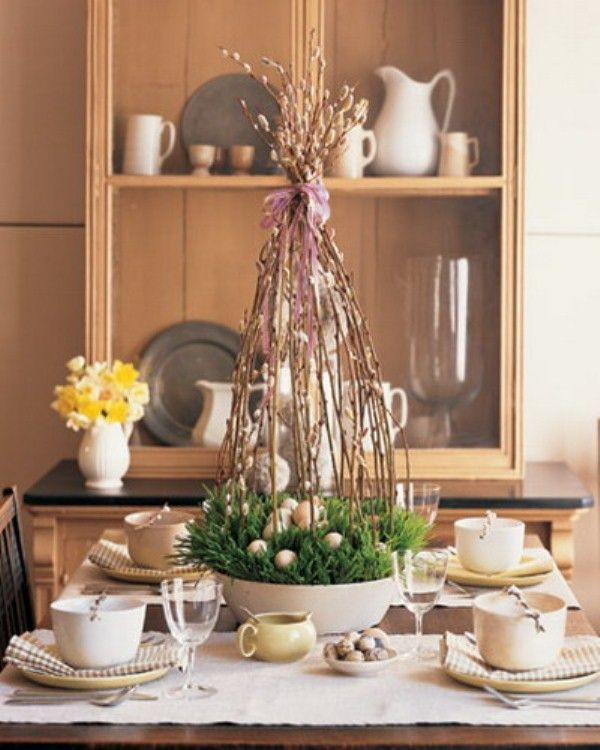 This is a great way to create height on a dinner or console table. If the eggs and grass are not pleasing to you, consider filling the bowl with flowers instead. Place floral foam on the bottom of the dish, wet, arrange flowers, finish with pussy willow branches/ribbon. Simple!  @digsdigs.com