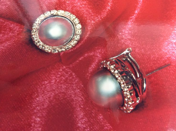 Platinum pearl and diamond cluster earrings with gallery detail to the side post and clip ear fastening