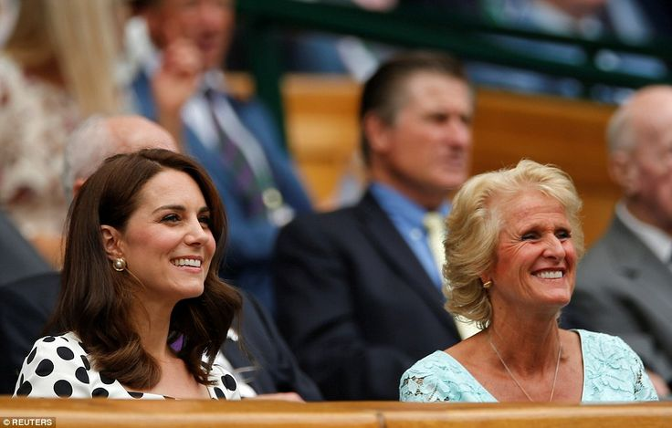 Kate takes in the action with Gill Brook, wife of the All England Club chairman Philip