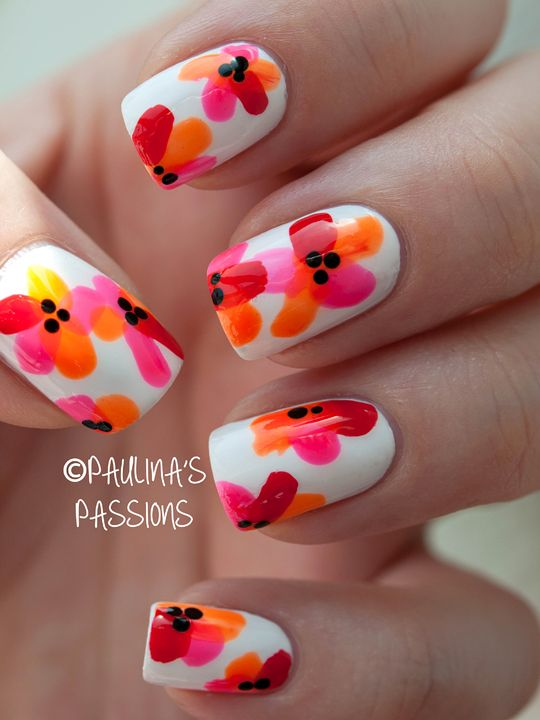 Solid white nails with multi color, single stroke flower petals, black dot stamens, easy free hand nail Art, water color inspired