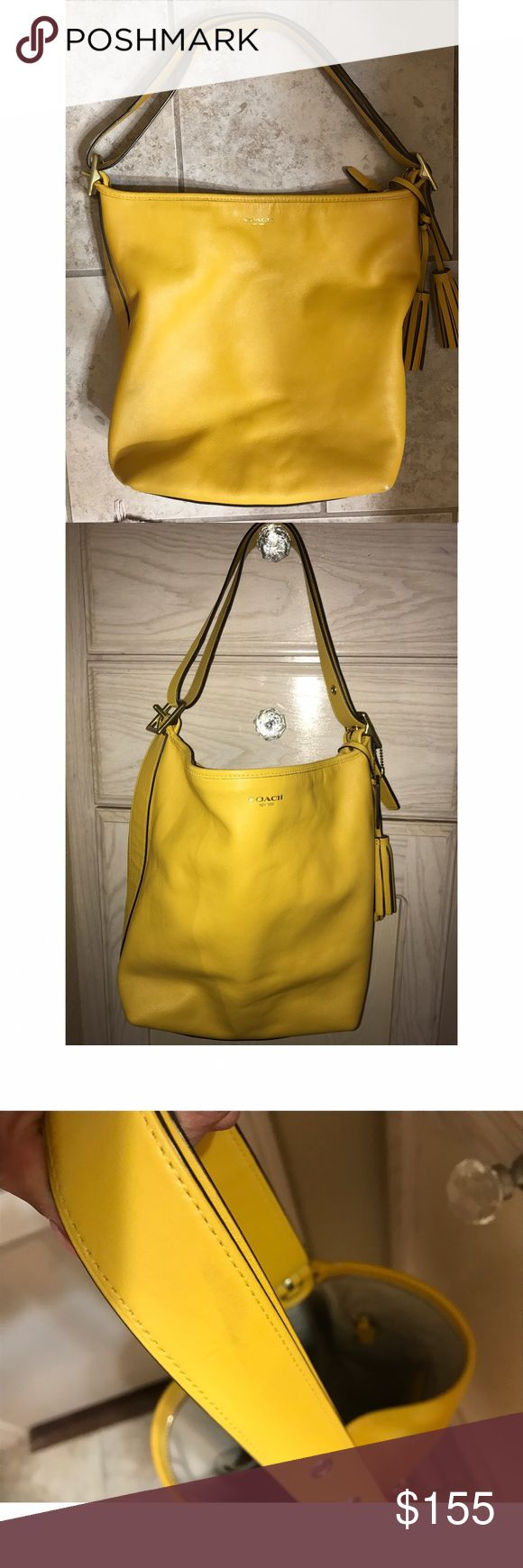 Coach Legacy Sunflower duffle tote purse Coach legacy bag in sunflower lightly used only very minimal visible marking on strap other than that inside is completely clean still have care card... no dustbag but in great overall condition Coach Bags Shoulder Bags