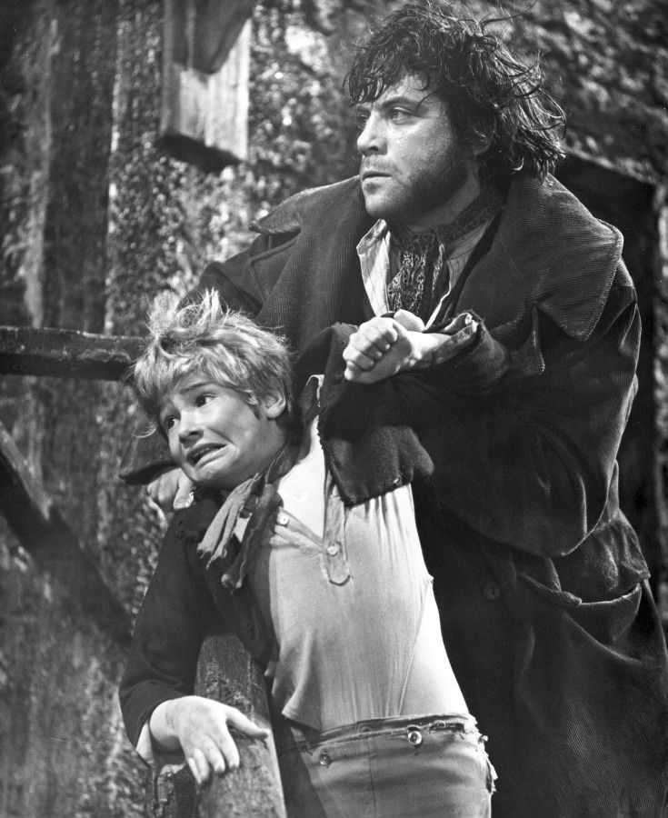 """Sir Carol Reed's film of """"Oliver!"""", 1968. Mark Lester as Oliver Twist and Oliver Reed (the director's nephew) as the evil Bill Sykes."""