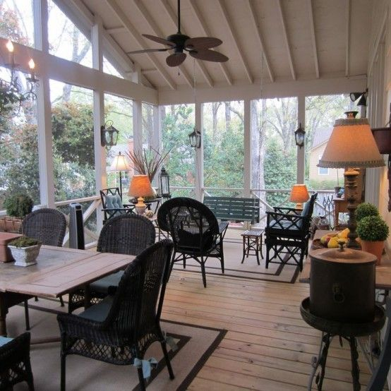 36 Amazing Screened Patio And Porch Décor Ideas : Spacious Patio With Black Patio Furniture And Ceiling Fan