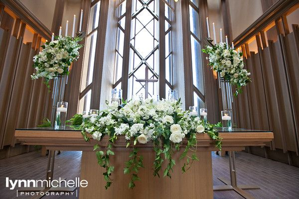 white themed wedding, beautiful white floral arrangement on church altar, Marty Leonard Chapel.