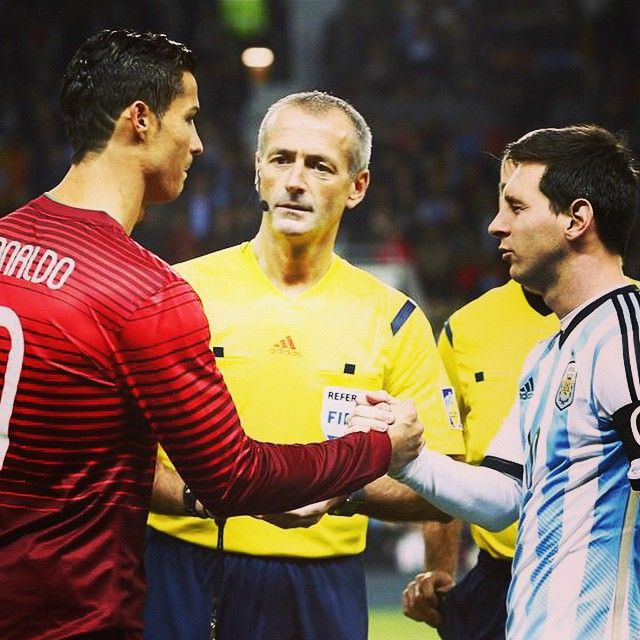 Cristiano Ronaldo and Lionel Messi.  I'm pretty sure the ref is having an internal freakout, haha, look at his face!  I mean, I get it, dude, I feel ya.