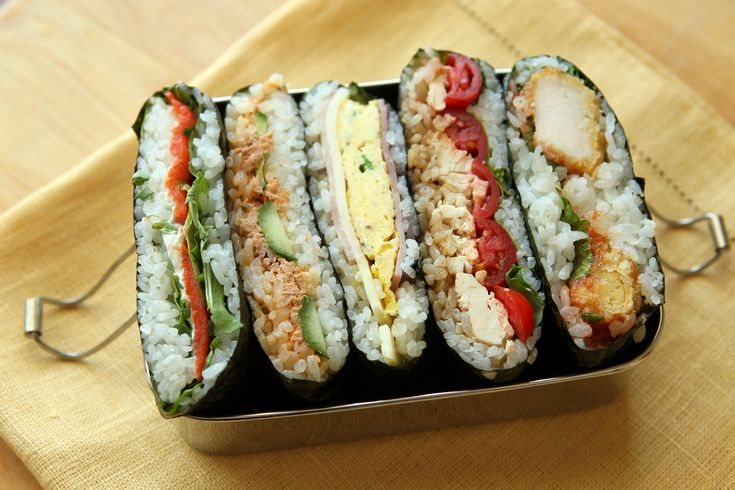 Onigirazu, a creative take on the traditional rice ball, is filled with ike ham, cheese with egg, tuna salad, fried chicken, or some left-over stir-fry,