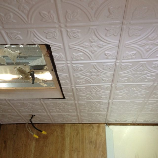 Plastic tin ceiling for the camper bathroom ! Easy to put up!