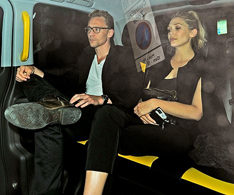 Tom Hiddleston and Elizabeth Olsen sit in the back seat of a taxi cab following a date night at The Wolseley.