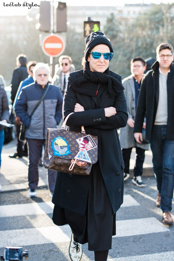 Womenswear Street Style by Ángel Robles. Fashion Photography from Paris Fashion Week.  Woman wearing bold accessories after Dior show, Paris.