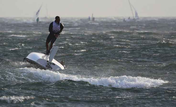Matias Montinho and Paixao Afonso of Angola hold on to their capsized boat…