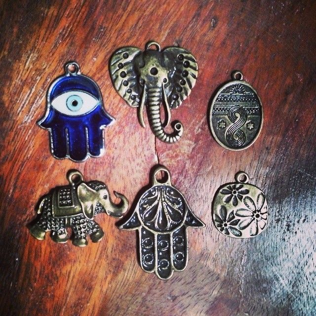 hamsa, elephant, & flower pendants.