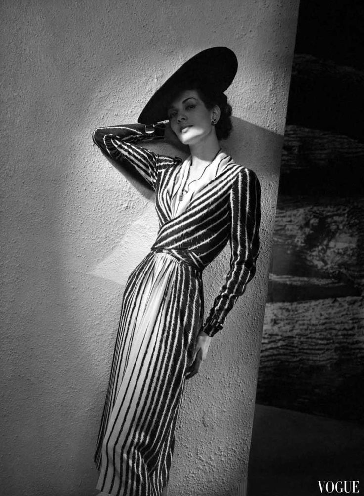 Model wearing a dress by Lucien Lelong, Vogue 1938, by André Durst