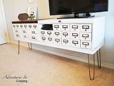 Industrial Decor-DIY safe deposit boxes turned TV console