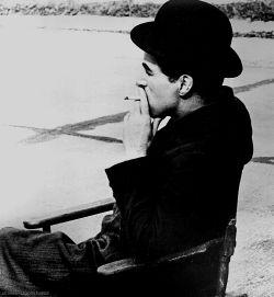 "charles–chaplin: """" Charlie Chaplin on the set of Modern Times, 1935 "" """