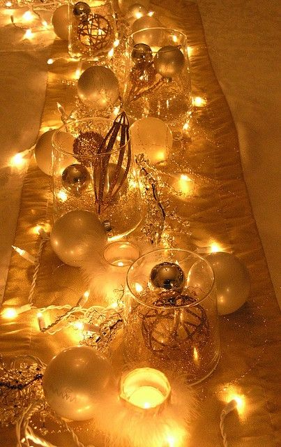 Christmas wedding table decorations in gold | instead, vase with white sand and bright green ornaments on top, with lights around? Or no lights. Keep it clean and simple feeling.