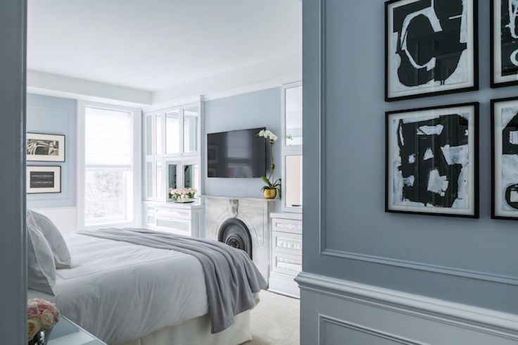 Beautiful, calming color scheme for a master bedroom... Bed across From TV above marble fireplace adorned with gold flower pot. Beautiful mirrored cabinets and dressers.