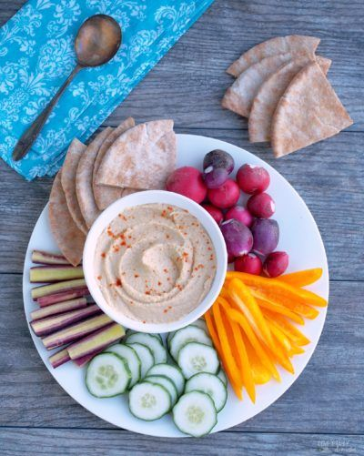 Skinny Hummus is nice and creamy with a nice bite of garlic—low fat Greek yogurt cuts down on the extra calories found in traditional recipes.
