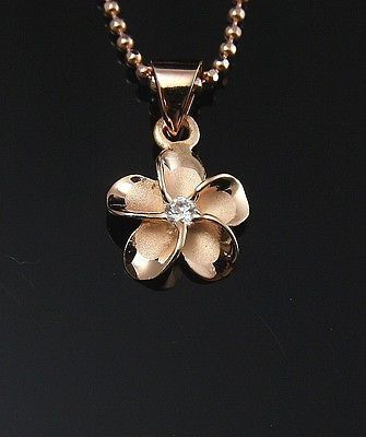 Click Here. Double your traffic. Get Vendio Gallery - Now FREE! Brand new pink/rose gold plated on solid 925 sterling silver Hawaiian Plumeria flower pendant Description : - Flower size: 10mm (approx.