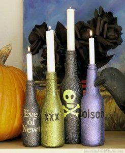 "Cast a spell with these bewitching candlesticks! Start by cleaning glass bottles inside and out. Give them a thrilling finish with Krylon Glitter Blast in Starry Night Sky, Citrus Dream, and Twilight Sky. Use sparkly stickers to label each bottle's ""hazardous contents."" Top the bottles with candles and give your haunted house a ghoulish glow."