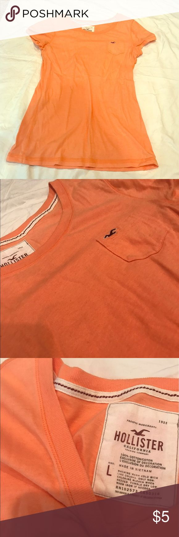 Orange Hollister tshirt True orange Hollister tshirt with pocket on left side. Small hole at bottom in from visible in last picture. Barely noticeable. Same or next day shipping. Hollister Tops Tees - Short Sleeve
