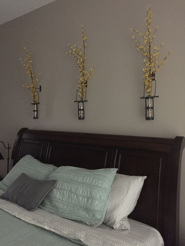 Glass wall vases. Bedroom décor. Yellow flowers from Hobby Lobby. Wall Vases from Wayfair  http://www.wayfair.com/Wall-Mount-Hanging-Cylinder-Vase-ATGR1568-ATGR1568.html