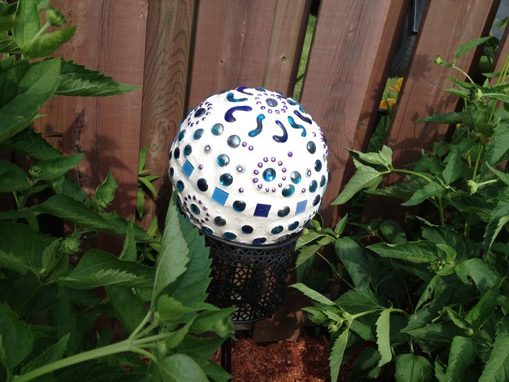Mosaic bowling ball. Hues of purple and blue (different angle). Beautiful accent to my backyard