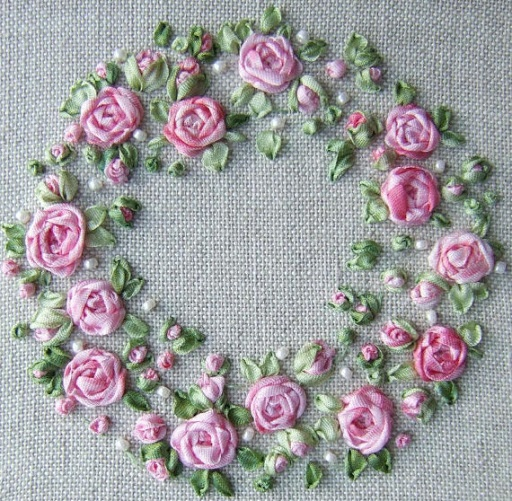 Silk roses....(oh my goodness! this pretty, pink wreath is so dainty. i love it!)....